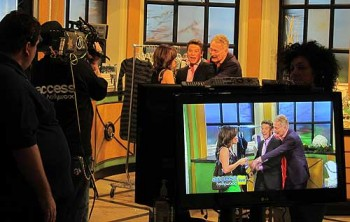 On the set of Access Hollywood with hosts Kit Hoover and Billy Bush.
