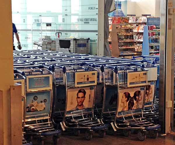 Stockholm airport Arlanda shopping: This is the way to the gates and lounge right after security at Stockholm's Arlanda airport. For years, the exit has been blocked by luggage carts.