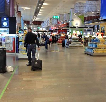 Stockholm airport Arlanda shopping: Forced to walk through the whole store because the handy exit at left is blocked with trolleys.