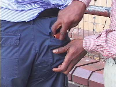 A pickpocket steals from the back pocket theft using speed, not stealth. Theft thwarter tips.