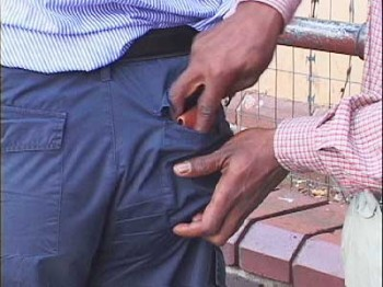 A pickpocket demonstrates a speedy back-pocket steal.