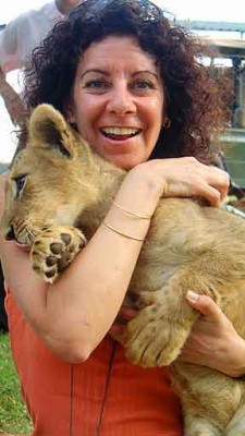 Bambi played, Bob wrestled, with a 14-week-old lion cub.