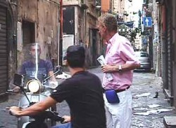 Two thieves on scooters corner Bob in Quartieri Spagnoli