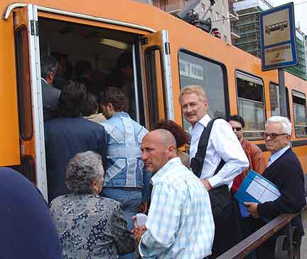 Bob Arno boards a crowded tram in Naples, Italy