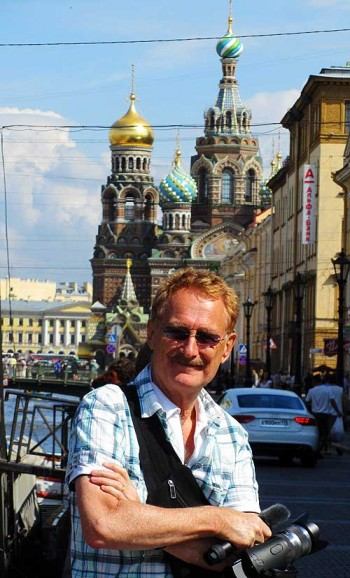 Bob Arno on the Canal Griboyedova bridge in front of the Metro station. In the background is the spectacular Church on the Spilled Blood.
