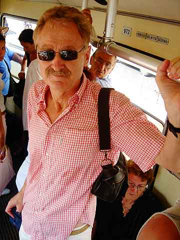 Off stage but on duty: Bob Arno films thieves on public transportation, here with a hidden camera in his right hand.