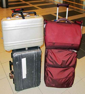 Luggage security. On the left: Bob's rig. A strip of white tape is just a spare piece, used to secure checked bags. On the right: Bambi's set-up. Not aluminum, but still like new after five years of hard use.