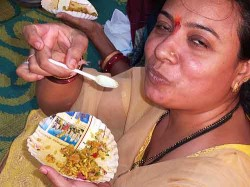 Savoring the last few bites of bhel puri on Chowpatti Beach