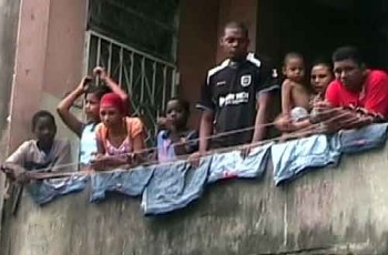 Muggers in Colon, Panama: People watch us from balconies all around us. Some dance. Quite a few men hold babies.