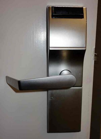 Electronic keycard lock on a hotel room door.