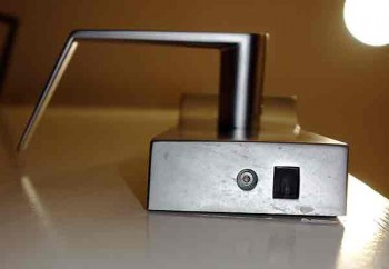 Electronic access points on the underside of a keycard lock.