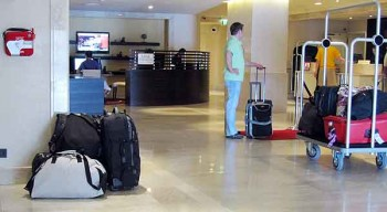 Hotel luggage storage: Who's watching the luggage? The single harried receptionist?