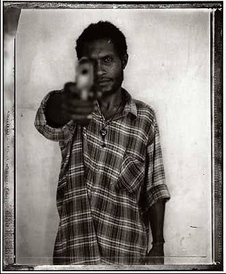 Anmember of the Raskol gangs of Port Moresby, Papua New Guinea. Photo by: ©Stephen Dupont (Contact Press Images)