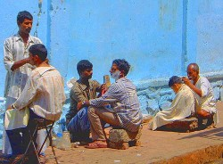 Sidewalk barbers in Bombay