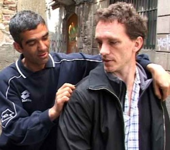 Pickpocket Kharem gets the victim to look back at his right shoulder. Meanwhile, his left hand opens the victim's left front jacket, exposing the breast pocket. How pickpockets steal from inside jacket pockets. steal from breast pocket