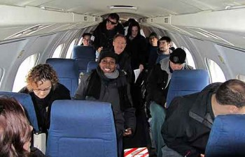 Artists, staff, and some crew board our little jet