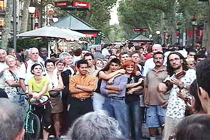 Eat, drink, and be merry on La Rambla. Great for people-watching. Great for pickpockets. (This is a frame-grab from video, hence the poor quality.)