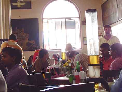 Eating Mumbai: Beer is served in tall, iced dispensers at Leopold's the famous cafe that was bombed in 2008.