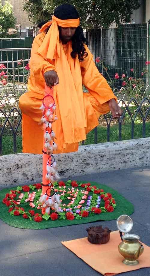Living statue street performers levitate