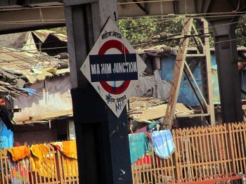 In a Mumbai slum: The Mahim Junction train station, with Dharavi behind