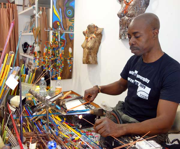 Venetian glass beads. Moulaye Niang at work in his Venice studio.