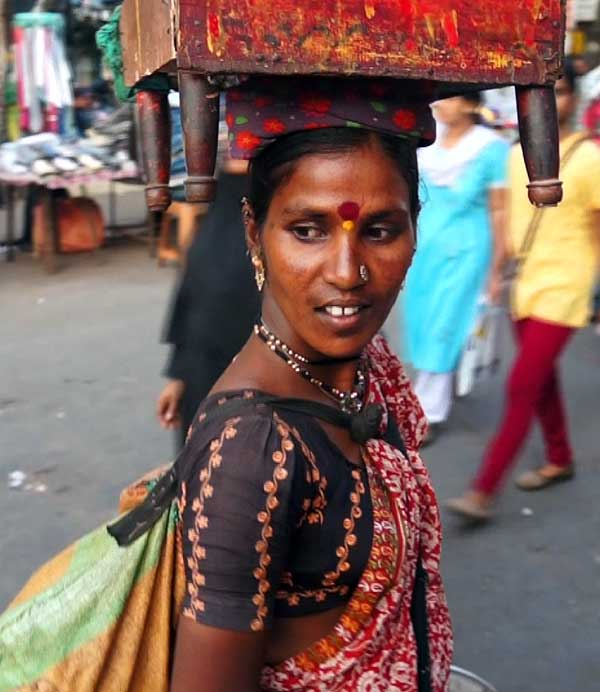 The heavy load on her head causes perfect posture and slow, elegant movements.