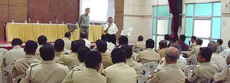 At Bob Arno's seminar at the Azad Maiden Police Station, video was projected onto a sheet taped to the wall.