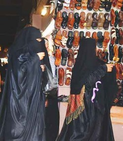 Many women in Oman are completely covered, even their eyes.