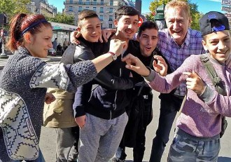 Paris pickpockets: The youngest child pickpocket called for a group photo. They posed and clowned, but none of them took photos of their own.
