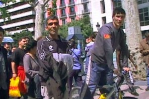 How pickpockets pick victims: Kharem, center, is a busy pickpocket in Barcelona.