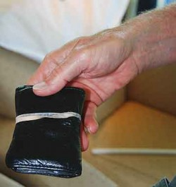 Many people believe that rubber banding a wallet, as Lionel shows, prohibits pickpockets. Pickpockets tell us otherwise.