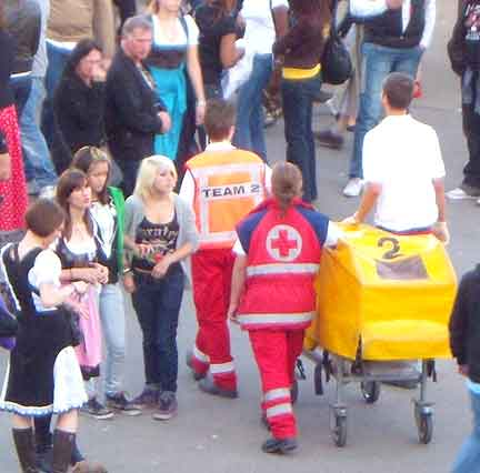 Roving red cross wheel the sick away on stretcher wagons with yellow vinyl tent covers for privacy, window in vinyl for light.