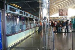 A new glass enclosure keeps the crowds away from travelers as they buy their tickets. Still, station police get about 50 reports of theft per day.