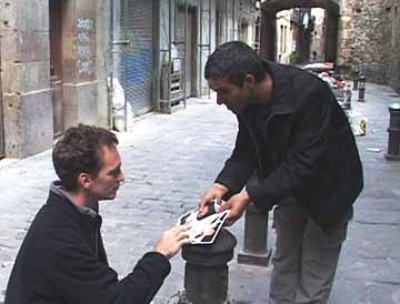 Pickpocket technique: Kharem fans out his postcards.